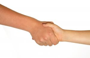 Q&A: Why do women shake hands with each other after a talim?